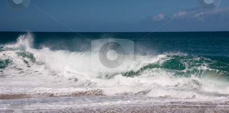 Waves breaking on sandy beach stock photo, Strong waves breaking onto the sandy beach on north shore of Kauai by Steven Heap