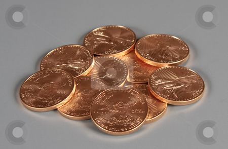 Pile of US Eagle gold coins stock photo, Stack of US Treasury 1 oz Eagle Gold Coins by Steven Heap