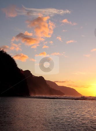 Vertical sunset of Na Pali coastline on the island of Kauai stock photo, Vertical format of the headlands of the Kauai coast illuminated at sunset by Steven Heap