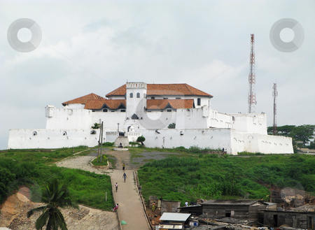 Elmina Fort near Accra in Ghana stock photo, Entry to Elmina Fort near Accra in Ghana with shanty buildings in the foreground by Steven Heap