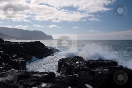 Rocky lava with waves stock photo, Waves breaking on the rocky lava coastline of north Kauai by Steven Heap