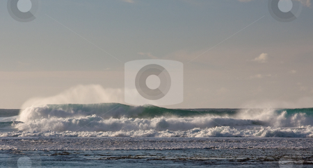 Waves breaking on the reef off a sandy beach stock photo, Breaking waves on the north coast of Kauai breaking on the reef by Steven Heap