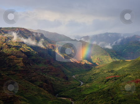 Rainbow falling on river in Waimea Canyon stock photo, Rainbow in the center of the river valley of Waimea Canyon on Kauai by Steven Heap