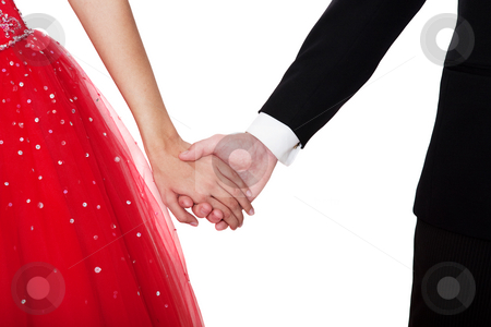 Boy Meets Girl stock photo, Boy & girl, in formal attire, holding hands against a white background. by Brenda Carson