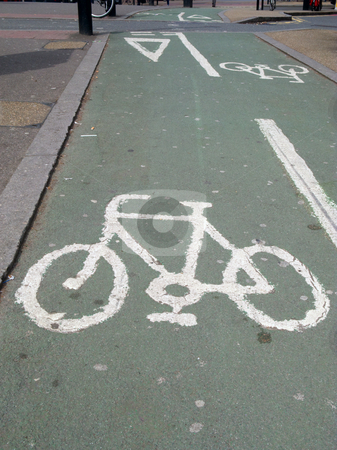 A cycle lane and white sign in London UK. stock photo, A cycle lane and white sign in London UK. by Stephen Rees