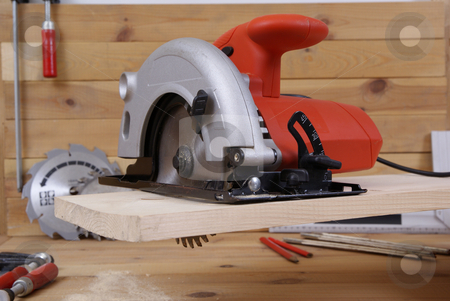 circular saw stock photo, circular saw and accessories on the board by Jolanta Dabrowska
