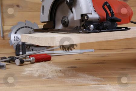 circular saw stock photo, circular saw and accessories on the board by Jolanta Dabrowska