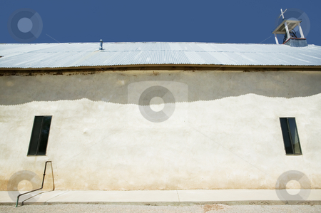 Side of rustic church stock photo, Side of rustic adobe church with corrugated metal roof by Scott Griessel