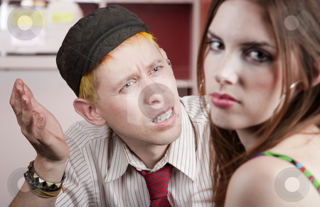 Young man and woman with a disagreement stock photo, Young man confused by disagreement with pretty woman by Scott Griessel