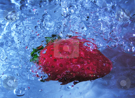 Strawberry in Water stock photo,  by Kirsty Pargeter