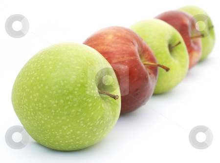 Red and green apples stock photo, Line of red and green apples - shallow depth of field used by Kirsty Pargeter