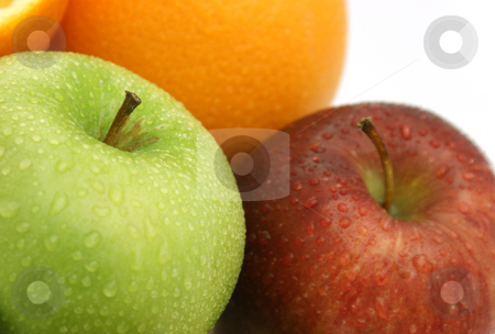 Apples and oranges stock photo, Freshly washed apples with oranges by Kirsty Pargeter