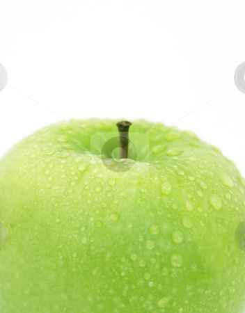 Apple with water drops stock photo, Fresh green apple with water drops by Kirsty Pargeter