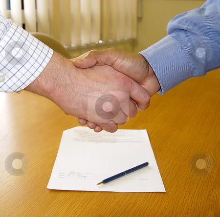 Male Hand Shake stock photo,  by Kirsty Pargeter