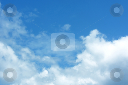 Blue sky with clouds stock photo, Background of blue sky with fluffy white clouds by Kirsty Pargeter