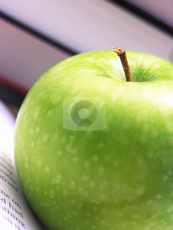 Apple with book background stock photo,  by Kirsty Pargeter