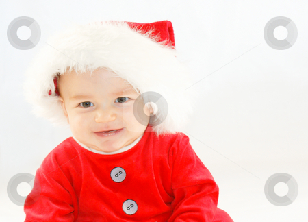 Baby santa stock photo, Smiling baby boy in santa outfit by Kirsty Pargeter