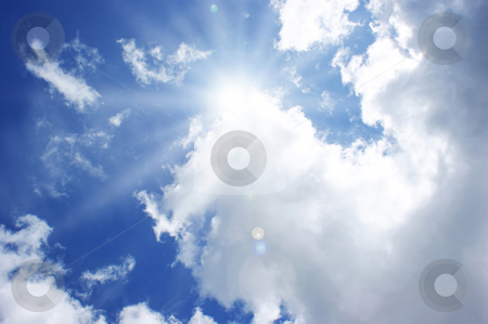Sunny blue sky stock photo, Sunshine in a blue sky with fluffy white clouds by Kirsty Pargeter