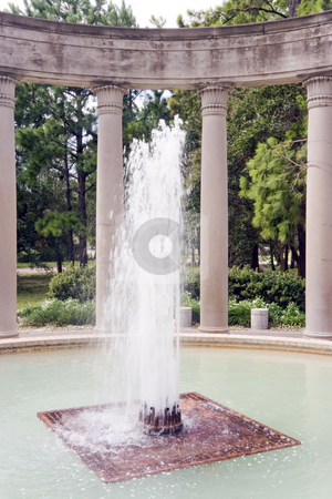 Fountain stock photo, A garden fountain that is infront of some columns by Kevin Tietz