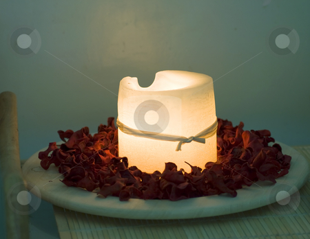 Candle stock photo, Great white candle surrounded with red rose petals by Fabio Alcini