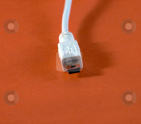 Usb stock photo, A white USB plug on red background by Fabio Alcini