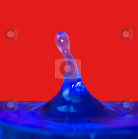 Drop stock photo, Drop of water on blue and red by Fabio Alcini