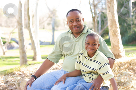 Man and Child Having Fun stock photo, Man and Child Having fun in the park. by Andy Dean