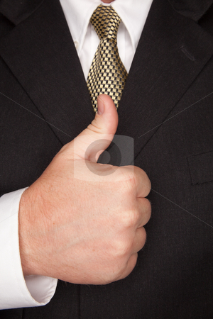 Businessman Gesturing Thumbs Up with Hand stock photo, Businessman with Coat and Tie Gesturing Thumbs Up with Hand. by Andy Dean