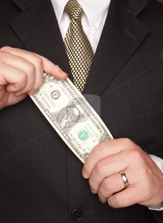Businessman Holding Dollar Bill stock photo, Businessman with Coat and Tie Holding Dollar Bill. by Andy Dean