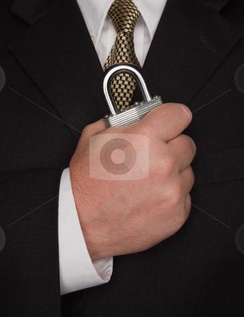 Businessman Holding Large Lock stock photo, Businessman with Coat and Tie Holding Large Lock. by Andy Dean