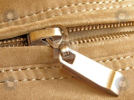 Fastener stock photo, On half unfastened metallic zipperr close-up by Sergej Razvodovskij