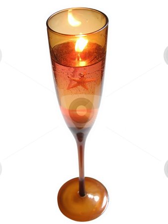 Candle in wineglass stock photo, Candle in wineglass with sea star and shells by Sergej Razvodovskij