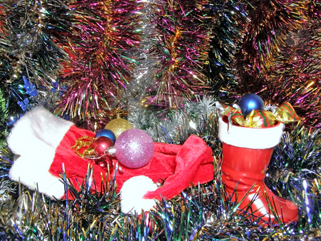 Christmas decoration and cup stock photo, A lot of multicolored decorations and sweets in Christmas boot by Sergej Razvodovskij