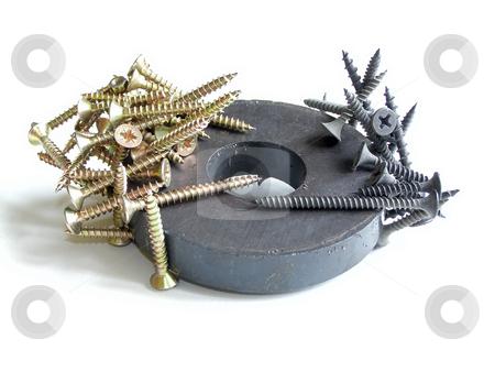 Attractive power stock photo, Yellow and black screws on magnetic circle by Sergej Razvodovskij