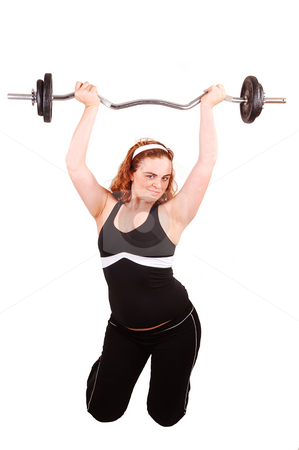Weight lifting girl. stock photo, Young girl lifting weight in the studio on her knees, to stay healthy and in good shape. by Horst Petzold