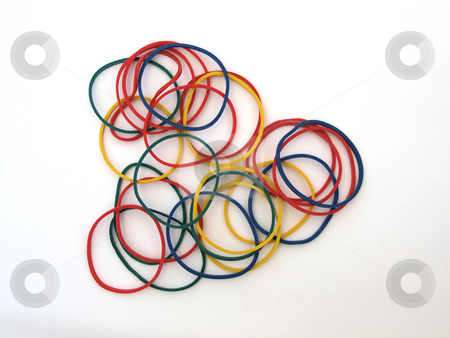 Colourful rubber bands stock photo, Close-up of colourful rubber bands on a whighr back ground. by Ian Langley