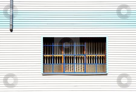 Window and gray pipe stock photo, Window on cheap plastic facade by Juraj Kovacik