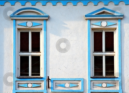 Blue windows stock photo, Blue windows on a old white building by Juraj Kovacik