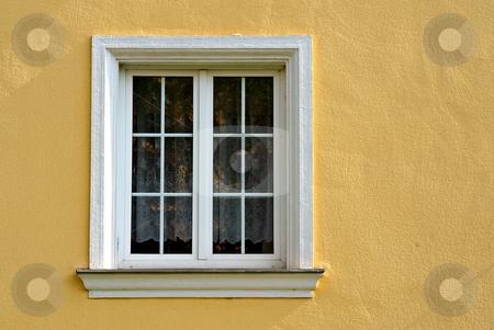 Window with white frame stock photo, Simple window with white frame on yellow facade by Juraj Kovacik