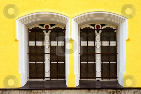 Two windows stock photo, Two windows on yellow facade by Juraj Kovacik