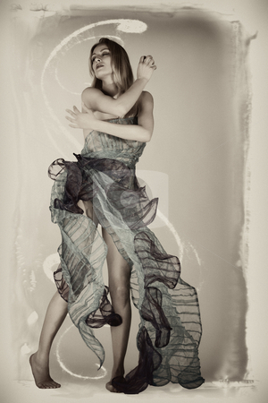 Classical and graphical view of beautifull woman dancing stock photo, Portrait of a thin woman in a designer dress high fashion style by Frenk and Danielle Kaufmann