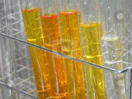 Test tubes stock photo, Test tubes lined up in a rack containing coloured fractions taken from a column chromatography separation by Casinozack