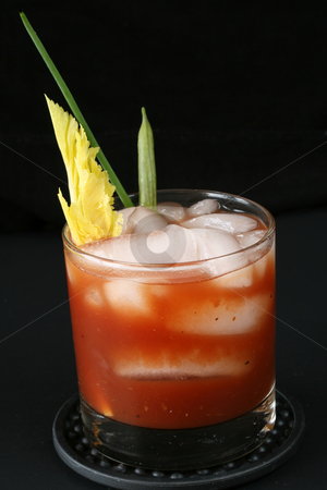 Bloody Mary  stock photo, Bloody mary cocktail with vegetable stirrers on black background by Linda Schhirmbeck