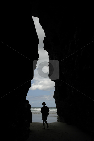 Cave stock photo, Man in the cave at the beach by Rui Vale de Sousa