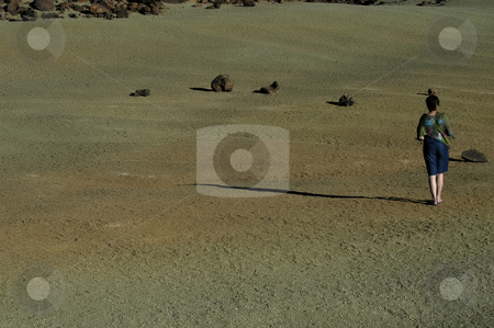 Walking stock photo, Young woman alone walking in the desert by Rui Vale de Sousa