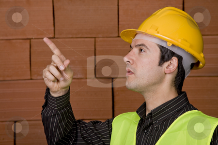 Architect stock photo, Engineer with white hat and a brick wall as background by Rui Vale de Sousa