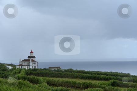 Lighthouse stock photo, Old lighthouse at the coast in azores island by Rui Vale de Sousa
