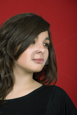 Looking stock photo, Young woman portrait isolated on red background by Rui Vale de Sousa
