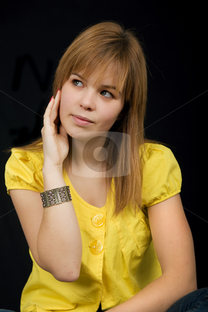 Pensive stock photo, Young beautiful blonde portrait against black background by Rui Vale de Sousa