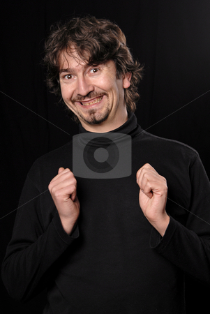 Silly stock photo, Young casual man portrait in black background by Rui Vale de Sousa